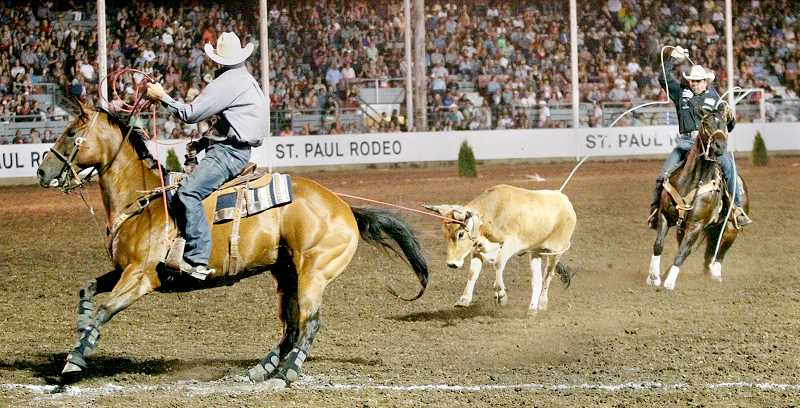 SUBMITTED PHOTO - Charly Crawford, Prineville, Ore., and Joseph Harrison, Overbrook, Okla. won the 2017 team roping title at the 82nd annual St. Paul Rodeo. They also set an arena record with a time of 4.1 seconds in the first round.