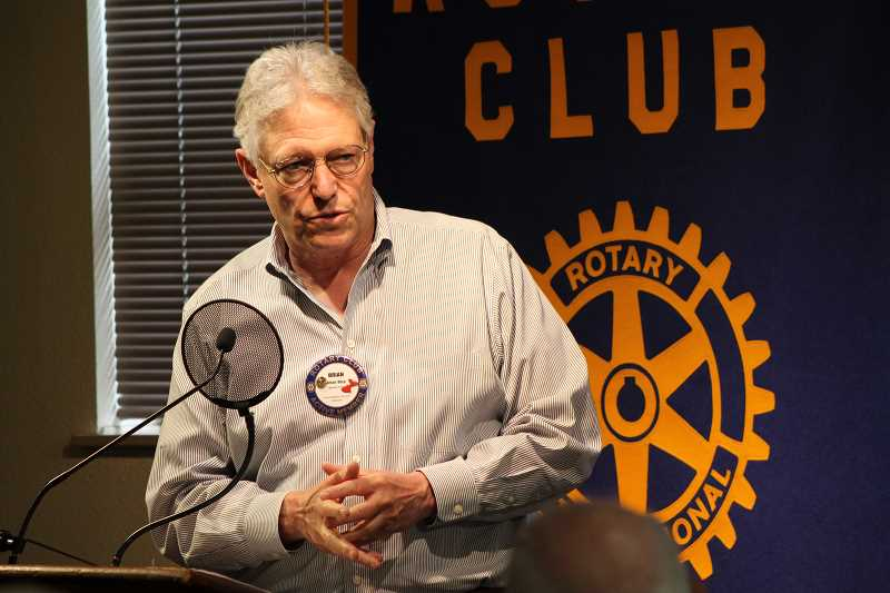 REVIEW PHOTO: JILLIAN DALEY - Brian Bice, a Rotarian on the SASEE Steering Committee, introduces the scholarship recipients at the Monday Lake Oswego Rotary Club meeting.
