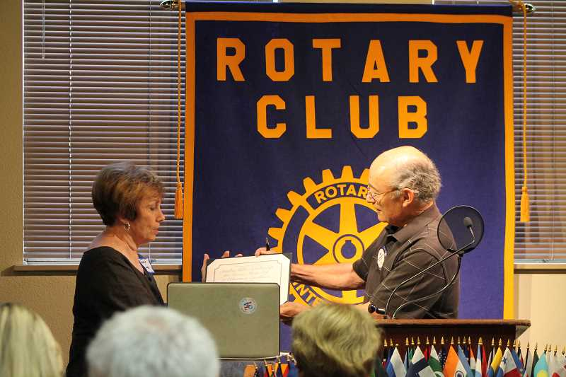 REVIEW PHOTO: JILLIAN DALEY - Eric Allenbaugh, a Rotarian on the SASEE Steering Committee, honors Service Above Self: Educational Excellence Award winner Sandra Miller. Part of the award in the category of Citizens/individals is having a scholarship given in your name.
