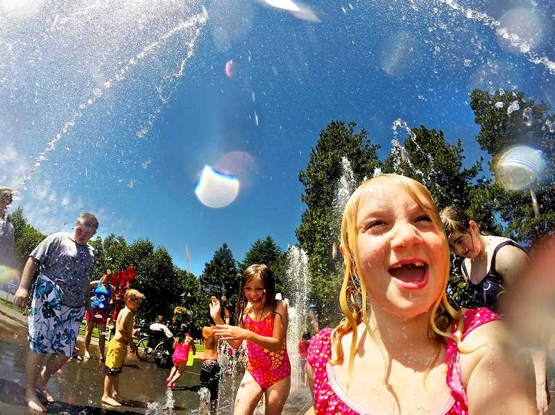 PAMPLIN MEDIA GROUP FILE PHOTO - Adults should keep a close eye on children as they frolick in the outdoors during hot days as they can become dehydrated quickly.