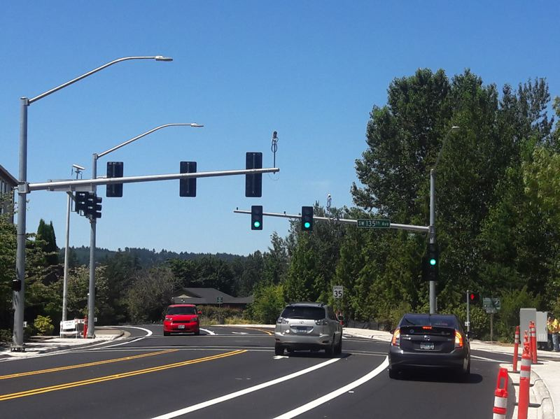 TIMES PHOTO: MARK MILLER - It's 'green light, go' at the intersection of Walnut Street and 135th Avenue in Tigard. New traffic signals are now operational at what used to be an all-way stop.