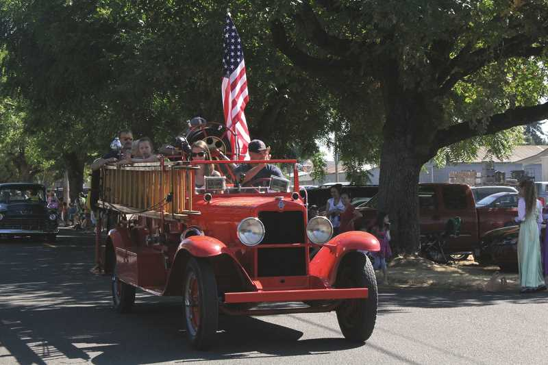 "INDEPENDENT FILE PHOTO - The historic engine fondly called ""Old Red"" is pictured in the 2012 Hop Festival parade. A pancake breakfast Sunday is a fundraiser to restore the vehicle."