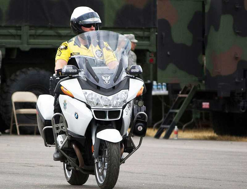 PMG FILE PHOTO - The Newberg-Dundee Police Department defunded its motorcycle officer positions in January as a cost-cutting measures.