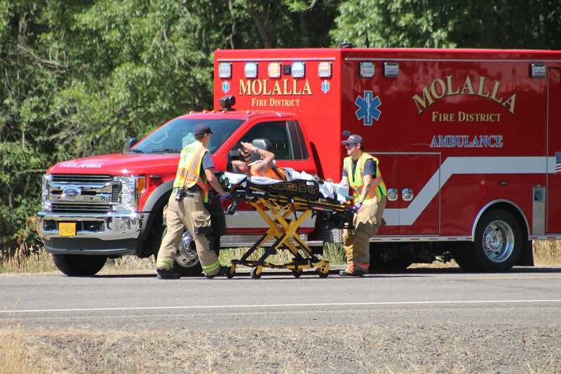 PIONEER PHOTO: CONNER WILLIAMS - A motorcyclist reportedly hit a vehicle that was attempting to turn near Highway 213 and Dryland Road Tuesday afternoon. He was taken to Legacy Silverton Medical Center for leg injuries.