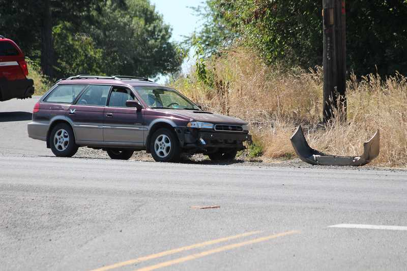 PIONEER PHOTO: CONNER WILLIAMS - The motorcyclist reportedly collided with this Subaru Outback as it was turning, likely onto Dryland Road. Its bumper can be seen lying on the road.
