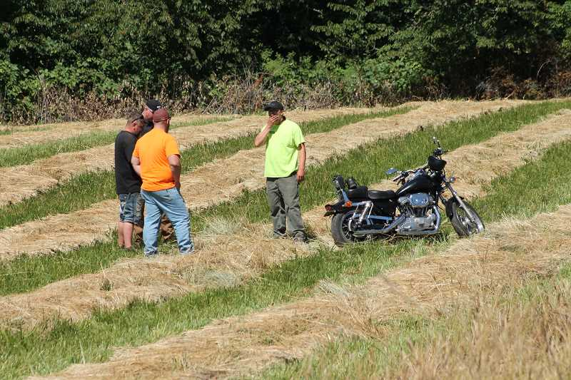 PIONEER PHOTO: CONNER WILLIAMS - The motorcyclist was apparently able to ride out the accident somewhat as his motorcycle can be seen standing upright in a nearby field. The motorcyclist is not pictured in this photo; he was taken to Legacy Silverton Medical Center for leg injuries.