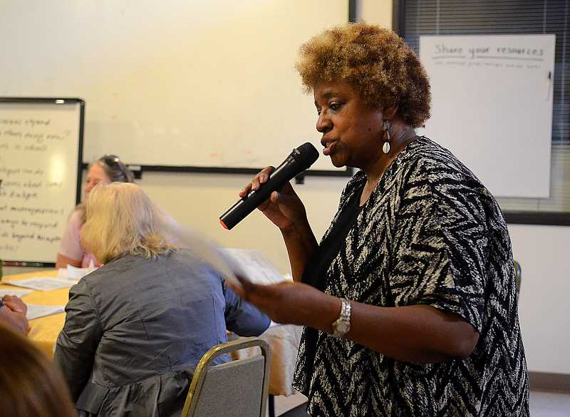 REVIEW PHOTO: VERN UYETAKE - Lake Oswego resident Willie Poinsette, one of the organizers of Monda'ys gathering, shares her own story with the group. 'When I want to go to the store,' she said, 'I rarely find anyone who looks like me.'