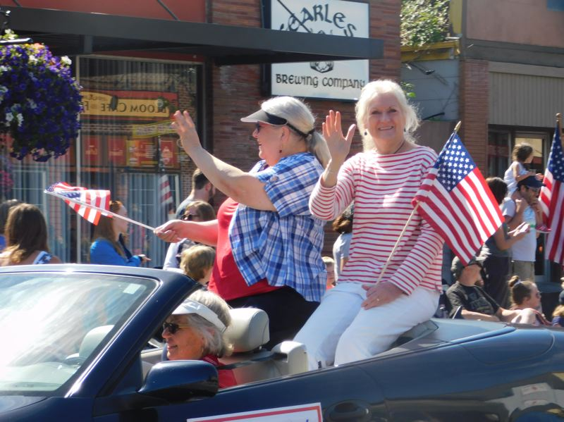 ESTACADA NEWS PHOTO: EMILY LINDSTRAND - Grand marshals Gloria Polzin and Jane Reid are all smiles as they wave to the crowd during the Estacada Fourth of July parade last week.