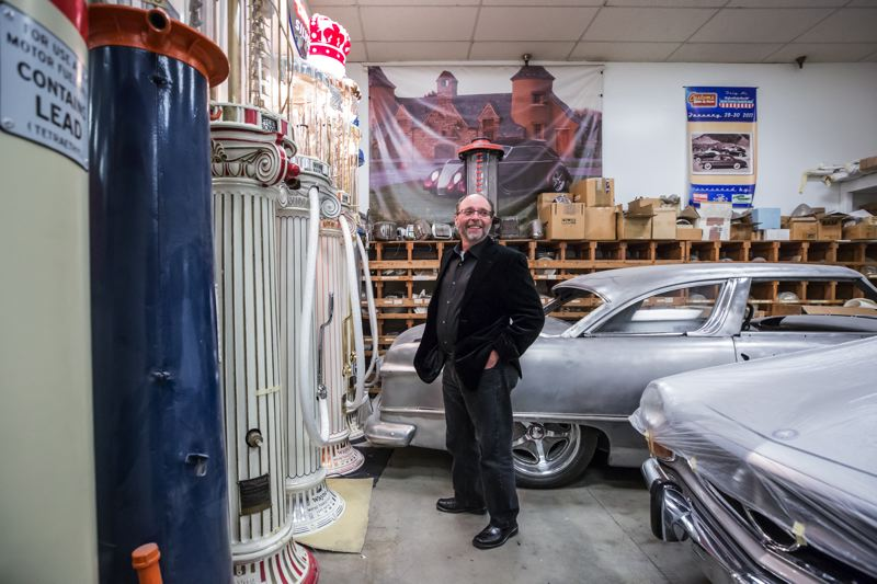 PORTLAND TRIBUNE: JONATHAN HOUSE - Renaissance Roadster co-designer and builder Steve Frisbie stands next to rare Roman Column Fuel Pumps from the 1920s. Working out of his East Portland shop, Steve's Auto Restorations, Frisbie has gained a worldwide clientele.