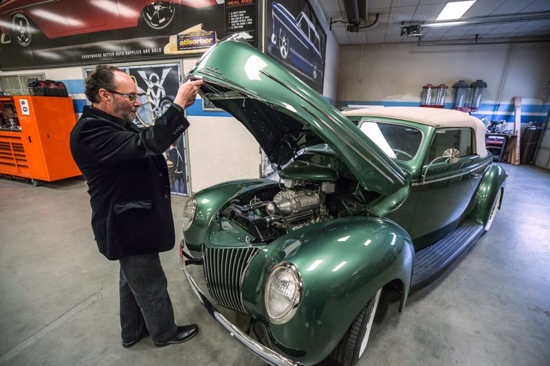 PORTLAND TRIBUNE: JONATHAN HOUSE - Steve Frisbie at his shop with a customer's project, a 1939 Ford Convertible with a supercharged, fuel injected flathead V8.