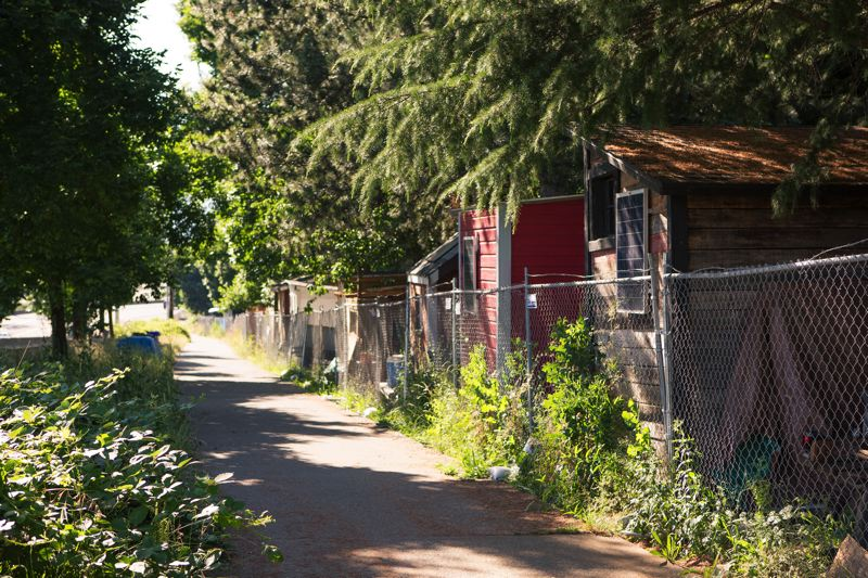 PORTLAND TRIBUNE: ADAM WICKHAM - Hazelnut Grove is clearly visible in the Overlook neighborhood. Advocates of the 'village' model say places like it offer homeless residents a social infrastructure lacking in shelters.