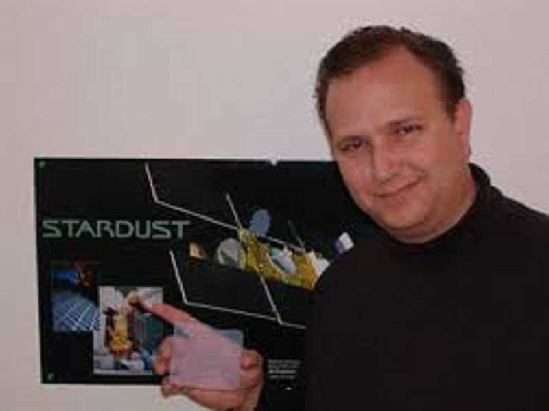 SUBMITTED PHOTO - Doug Buettner showing a sample of the aerogel material he helped develop while working with a NASA scientist.