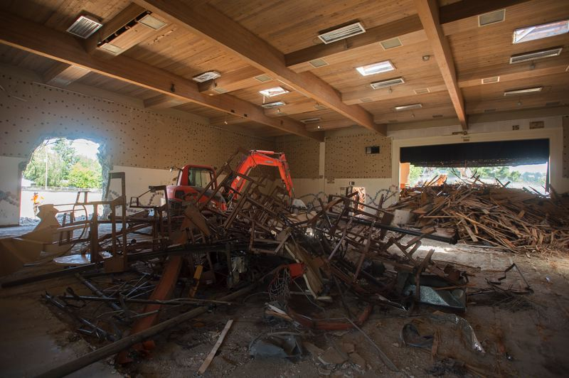 OUTLOOK PHOTO: JOSH KULLA  - The original part of Troutdale Elmentary School was dedicated on Dec. 1, 1926 and was added on to several times. The original four-room schoolhouse cost $29,000. Its replacment will be around $32 million. Here, the old gymnasium undergoes demolition last week.