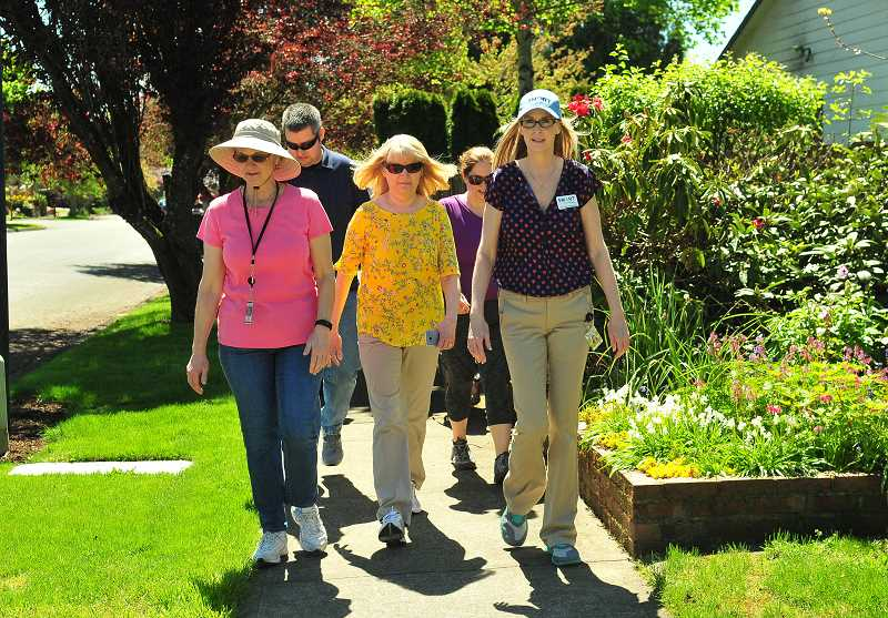 SPOKESMAN FILE PHOTO - Join your neighbors for a mid-day walk through a different part of town each week. Walk Smart begins at noon, this week meeting at the Fred Meyer Garden Center.