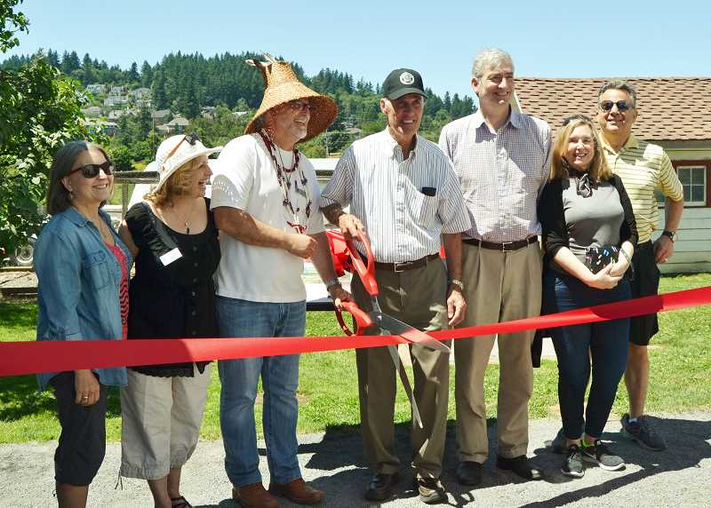 PHOTO COURTESY OF AMY COOK - City officials and community members prepare to cut the ribbon Saturday at the opening of the Hazelia Agri-Cultural Trail (from left): West Linn City Councilor Teri Cummings, Clackamas County Commissioner Sonya Fischer, Grand Ronde Tribal Council Secretary Jon George, Lake Oswego Mayor Kent Studebaker and Lake Oswego City Councilors Jeff Gudman, Jackie Manz and John LaMotte.