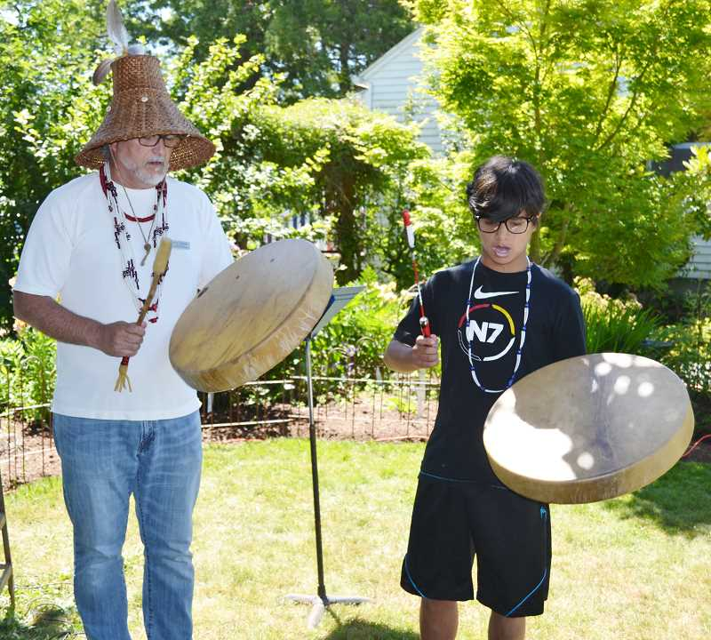 PHOTO COURTESY OF AMY COOK - Grand Ronde Tribal Council Secretary Jon George and his son Ty George performed a drum song as part of the ribbon-cutting ceremony.