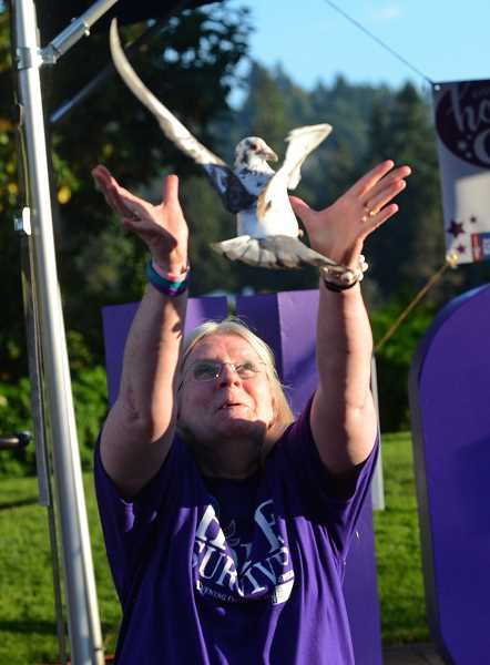 REVIEW PHOTO: VERN UYETAKE - Jolene Kane of Lake Oswego releases a dove at the Evening of Hope in Millennium Plaza Park, celebrating nine years and nine months as a cancer survivor.