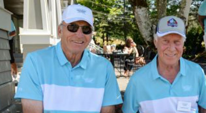 COURTESY: TREVOR POUND, PORTLAND-PHOTOGRAPHY.COM - Former Oakland Raiders receiving great Fred Biletnikoff (right) joins co-host Dave Wilcox, who played linebacker for the Oregon Ducks and San Francisco 49ers, at a celebrity benefit golf tournament Monday at Pumpkin Ridge.