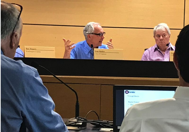 TIMES PHOTO: DANA HAYNES - Tualatin Mayor Lou Ogden, left, and Durham Mayor Gery Schirado hear from Metro planners.