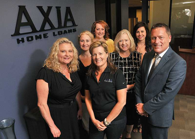 STAFF PHOTO: VERN UYETAKE  - Axia Home Loan owner-employees welcome the public to the Celebrate Our Success party taking place today, July 13 from 4-7 at the Lake Oswego office. From left are: front row, Kathy Weaver, Gina Fanucchi, Scott Mattern; second row, Emily OConnell and Loretta Alexander; and back row, Michelle Hollenbeck and Rachel Goffard.