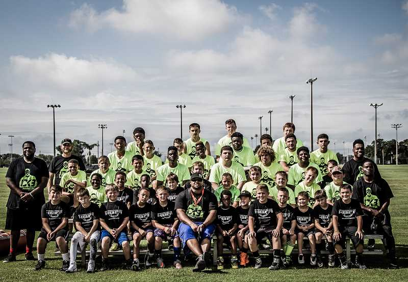 SUBMITTED PHOTO: CKB SPORTS - Kirk Broussard (front middle) poses for a photo with cmapers and coaches from one of his skills camps this year.