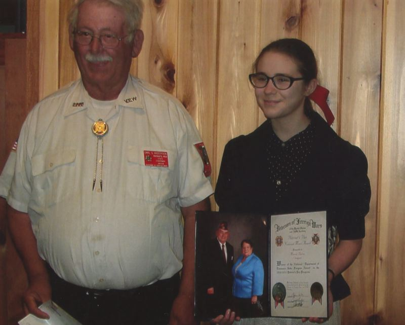 PHOTO COURTESY OF SALLY ANN MARSON - Columbia City teen Maria Burns, right, stands with Carl Anderson, Patriot's Pen Oregon chairman and member of Veterans of Foreign Wars, during an awards ceremony Monday, July 10.