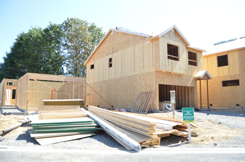 SPOTLIGHT PHOTO: COURTNEY VAUGHN - New homes in the South Fork subdivision in Scappoose are being built rapidly, but workers on site say their companies face a shortage of qualified labor.