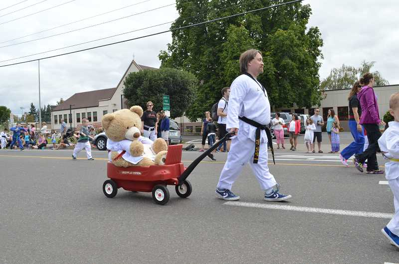 GAZETTE FILE PHOTO - The annual Robin Hood Festival parade attracts hundreds of residents who line Sherwood 