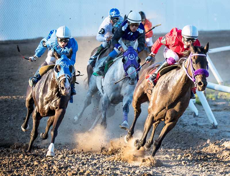 LON AUSTIN/CENTRAL OREGONIAN - Jake Samuels aboard See the Lite (far right) comes off the corner leading a group of horses in the second race at Wednesday's opening night of the Crooked River Roundup Race Meet. Racing continue through Saturday night.