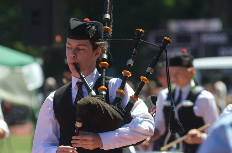 OUTLOOK PHOTO: CLARA HOWELL - The crowd applauds the bagpipers and other musicians at the annual Scottish event.