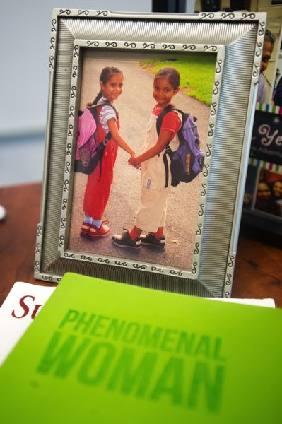 OUTLOOK PHOTO: JOSH KULLA - Now 20 years old, this photo of Katrise Perera's twin daughters has followed her across the country as she has advanced her career in education. 'They go everywhere with me,' she said.
