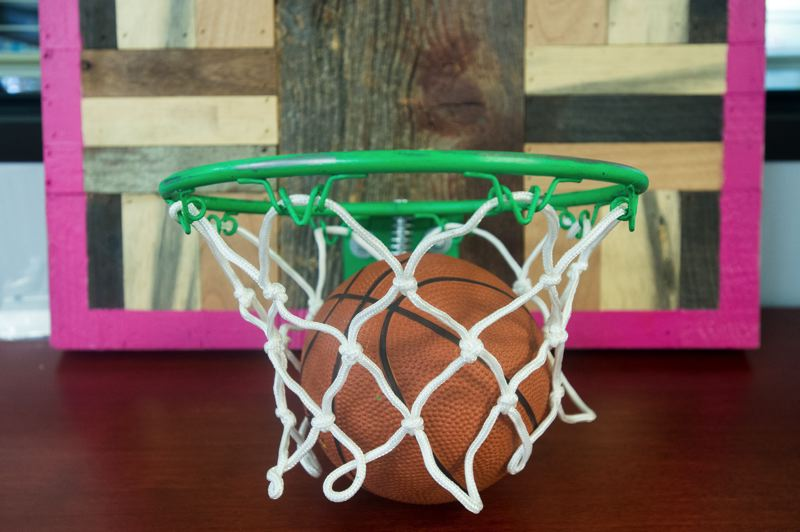 OUTLOOK PHOTO: JOSH KULLA - Katrice Perera was a college basketball player of some renown during a career at the University of Louisiana at Monroe. Today, she keeps this handmade basketball hoop in her office as a keepsake of her athletic days.