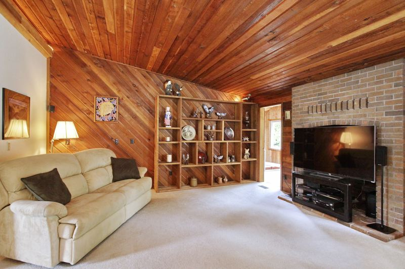 CONTRIBUTED - A vaulted family room provides space for the whole household to gather and relax.