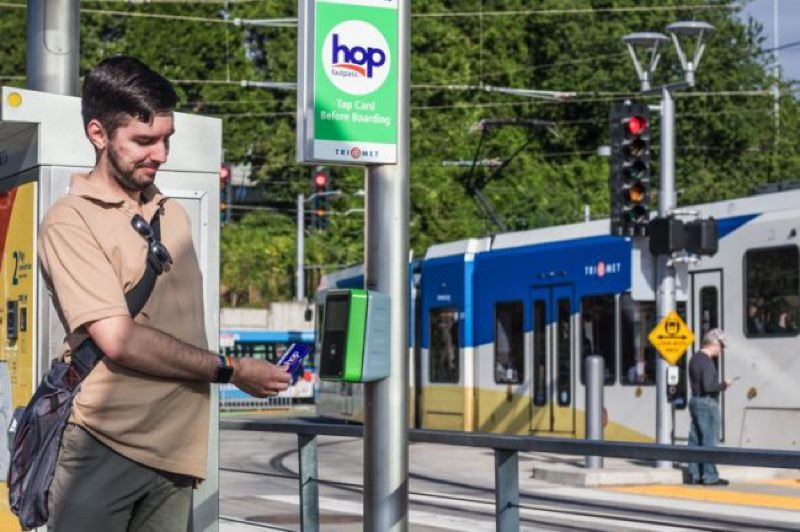 TIMES PHOTO: JONATHAN HOUSE - Stephen Weber had been beta testing the Hop Fastpass for TriMet since March. An IT professional, he's excited to see how TriMet might use data from the new card to improve its transit systems.