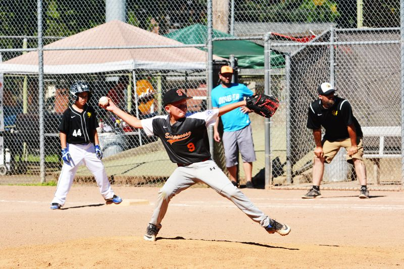 SPOTLIGHT PHOTO: JAKE MCNEAL - Brayden Miller of Scappoose (9) delivers a pitch.