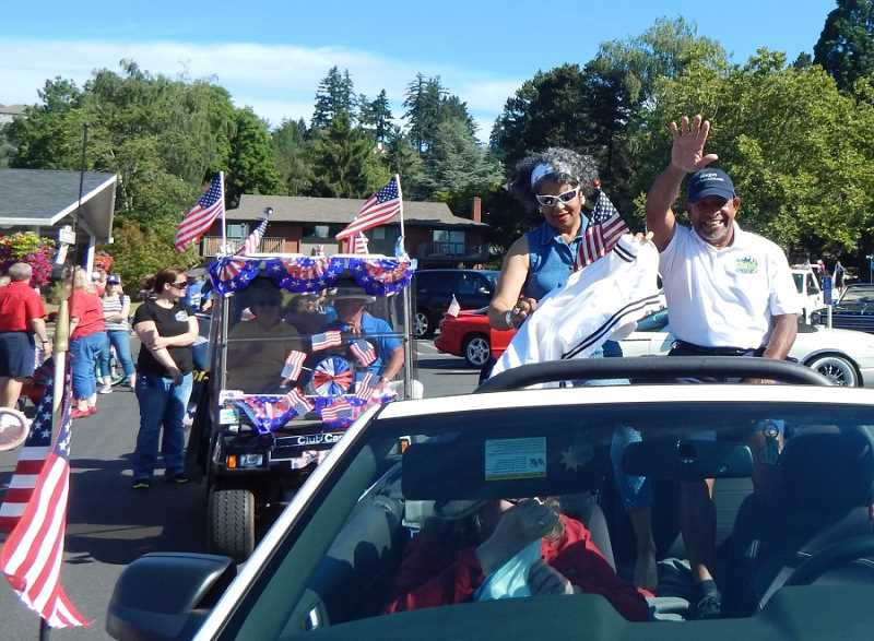 King City Mayor Ken Gibson and his wife Ramona rode in style at the front of the Fourth of July Walk & Roll Parade & Festival, with more than 300 people participating in the parade that started at the King City Clubhouse and ended at King City Community Park in Edgewater on the Tualatin.