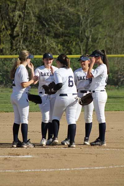 SUBMITTED PHOTO: LEGAL AID AT WORK - Lake Oswego students talk softball while standing on the dirt field they are currently using.