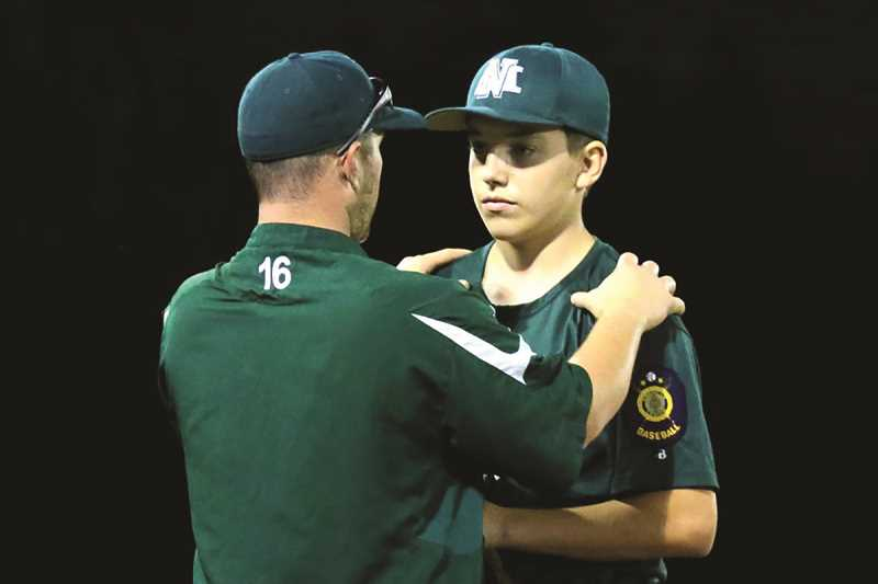 JO WHEAT - Pitcher Calvin Sahlin talks with assistant coach Tucker Brack. Sahlin is one of nearly two dozen teammates from North Marion High School to help give the program's Legion team a full roster without having to draw from other schools around the region.