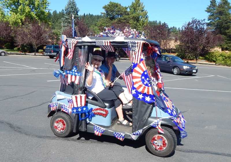 REGAL COURIER PHOTOS: BARBARA SHERMAN - There was no room left on this golf cart to place any more Fourth of July decorations as it leaves the King City Clubhouse parking lot at the start of the annual Golf Cart Parade on July 3.