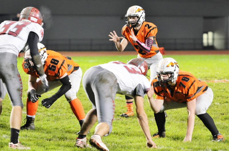 SPOTLIGHT PHOTO: JAKE MCNEAL - Quarterback Jerad Toman (2), offensive linemen Nate Maller (58) and Trey Bispham (76) can help the 2015 Class 4A runner-up Indians to at least the first round of Class 4A state for the sixth year in a row.