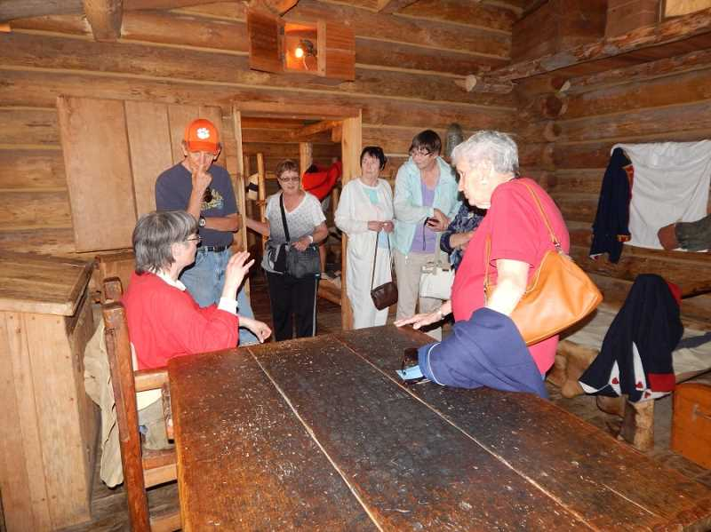 Inside one of the rooms in the Fort Clatsop replica, a guide (seated at left) describes what types of jobs the men in the Corps of Discovery did during the winter of 1805-06.