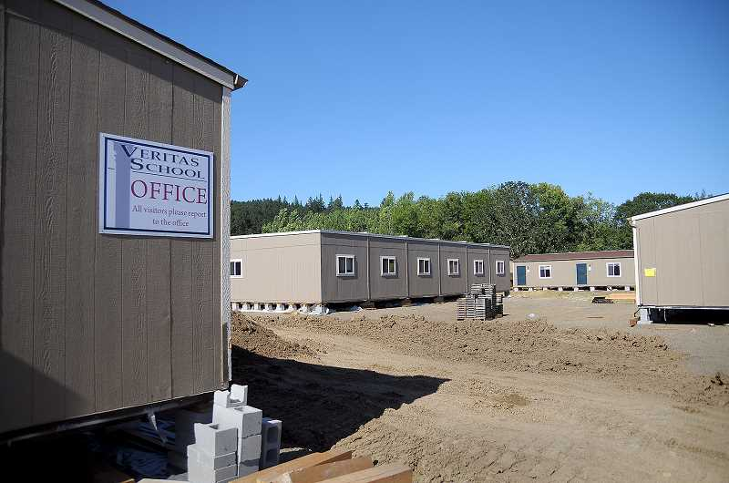 SETH GORDON - Veritas School moved its modular classrooms from First Presbyterian Church to its own property at the corner of Highway 219 and Northeast Bell Road in June and is preparing to operate from its new home beginning this fall.