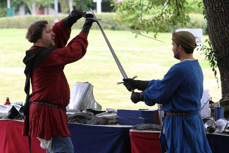 SPOKESMAN PHOTO: ANDREW KILSTROM - Eric Slyter, left, demonstrates a knight's thought process during combat from the medieval time period.