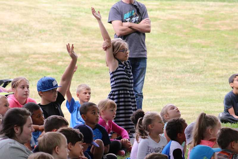 SPOKESMAN PHOTO: ANDREW KILSTROM - Kids were full of questions about knights and the medieval time period during Thursdays program July 13.