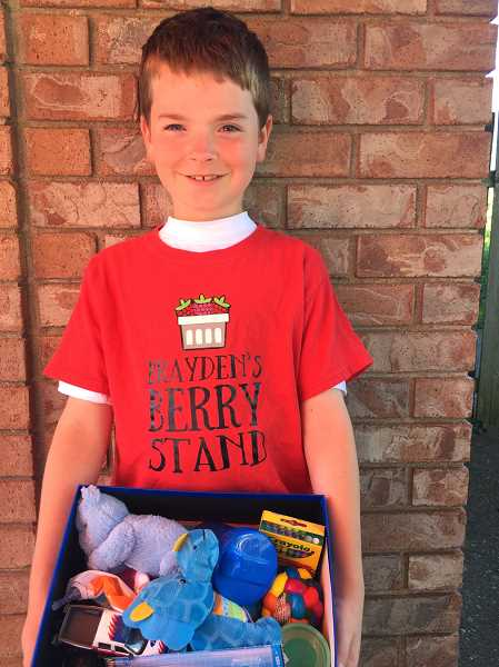 SUBMITTED PHOTO - Brayden Arsenault sells a box of berries, with proceeds going to the creation of welcome boxes he then donates to local kids entering fostercare.