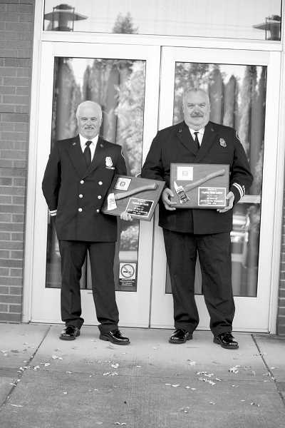 COURTESY PHOTO - Forest Grove Fire & Rescue Capt. Joseph Smith and Capt. Mike Lanter were honored for 30 years of service at last Mondays Forest Grove City Council meeting.