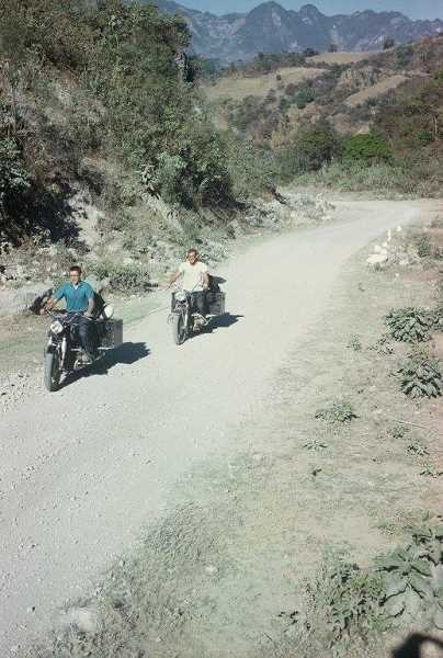 SUBMITTED PHOTO - At one point in their storied trip 54 years ago, (from left) David Yaden and Keith Thye recall a scene from southern Mexico where Thyes clutch went out. For three days and 100 miles through a section of Guatemala known as the El Tapon landslide area, Yaden was forced to tow Thye and his bike. The pair said the going was easy rolling up, rather than down, hills like this one because the downward slope created too much slack in the line.