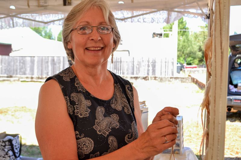 POST PHOTO: BRITTANY ALLEN - Twlya McIntyre has brought her Paisley and Spice creations to the Mount Hood Farmers Market for three years.