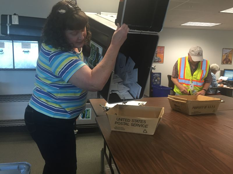 PARIS ACHEN/CAPITAL BUREAU - (File photo) Election workers at the Marion County Clerk's Office in Salem sort ballots from a ballot drop in 2016.