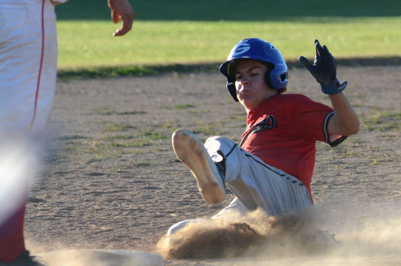 OUTLOOK PHOTO: DAVID BALL - Greshams Jaden Sare slides safely into third base with a steal and would steal home later in the fourth inning of the teams 11-1 home win over Tigard on Monday night.